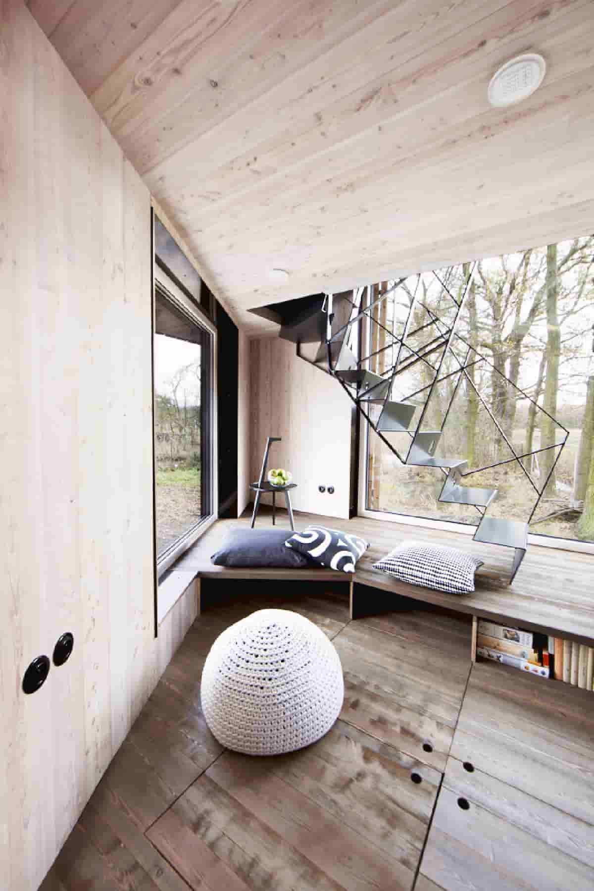 Design an open-plan, low-energy wooden house to improve the closeness of the family