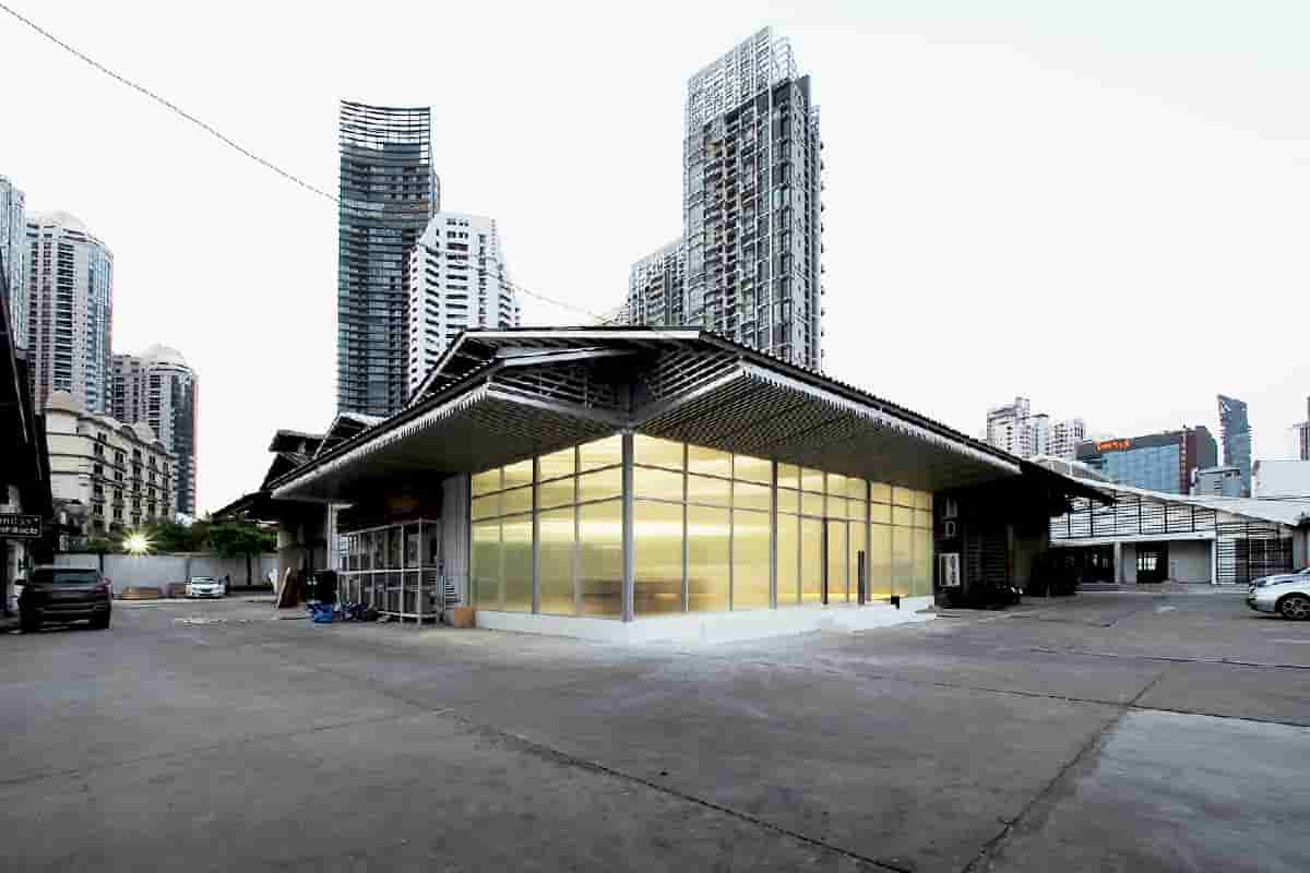 An Opaque Former Warehouse Converted to a Ripple Glass Facade Office